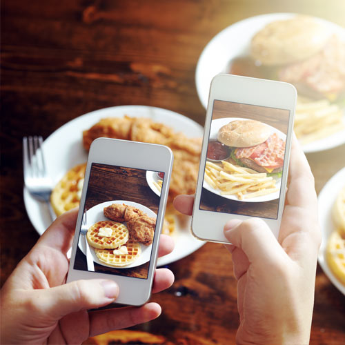 People Taking Pictures of a Meal on Their Phones