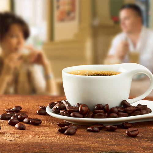 Coffee on a Table with Coffee Beans