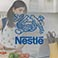 Nestle logo with woman cooking