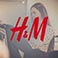 H&M Logo with woman shopping